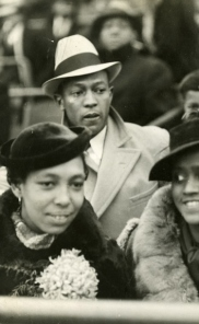 Jesse and Ruth Owens sitting with an unknown group of people, ci